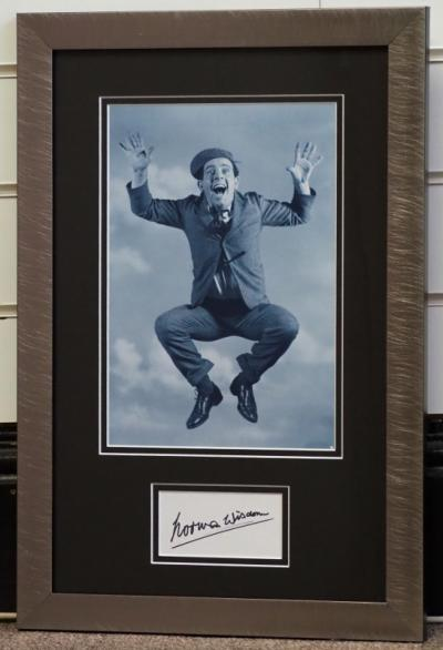 Norman Wisdom signed display